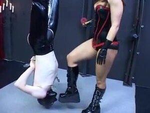 Mistress fucks her slave with a dildo
