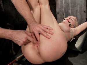 Busty blonde in hogtie anal toyed