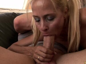 Adorable blonde chokes on a stiff pecker and gets