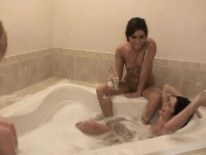 Sexy dark-haired chick gets all wet while taking a