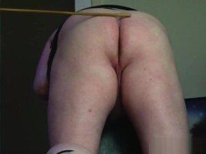 Miss Sultrybelle caning Whacker with her 3