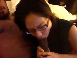 Asian amateur chick in glasses sucking big black