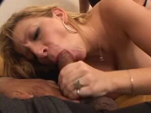 Blonde MILF in thong squeezes her big nice tits on