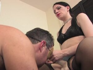 Dark haired Mistress in pantyhose with strapon
