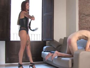 Dominatrix caning useless slave