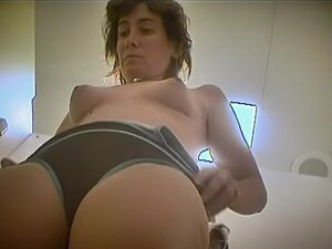 Woman with cute face and nice small tits puts on