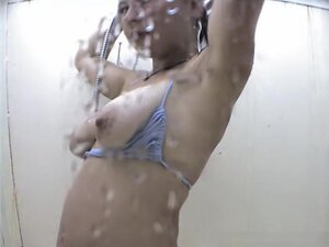 Milf sliding bikini aside and flashing tits with