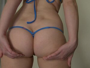 Addie Juniper models several micro bikinis with