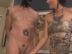 Buxom brunette mistress plays with her slave