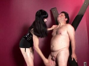 Mistress on heels spanking and cock torturing tied