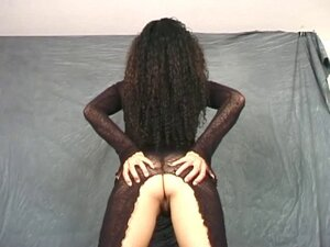 Solo curly hair model in a sheer black dress to