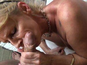 Blonde milf with pierced nipples sucks a huge