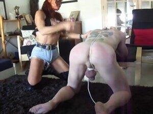 Submissive male bent over for hard spanking,