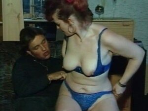 Sexy redhead MILF gets fingers up her