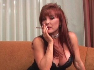 Redhead MILF with large tits sucks dude