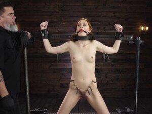 Slave in doggy device bondage fingered
