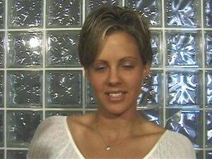 Cute brunette in short-cut hair strips on cam