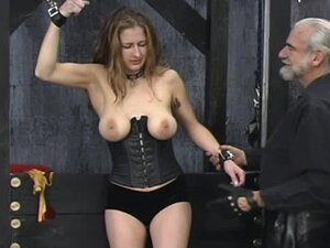 She puts on corset for bondage scene