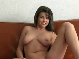 Sexy busty brunette fucking on leather couch