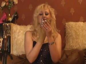 Blonde Mistress Smoking & Showing Off Her Leather
