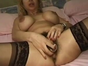 very hairy MILF fisting her ass,