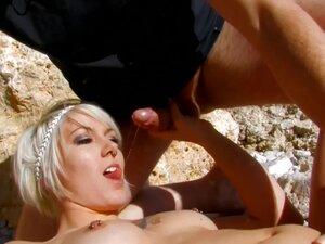 Tattooed beach girl gets sprayed with cum